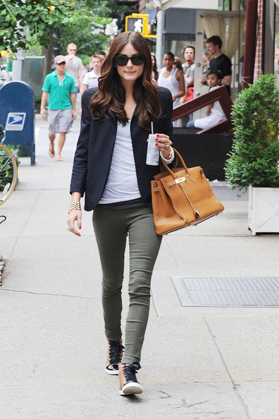 ".Olivia Palermo shows off her new sneakers and Birkin bag while heading to the set of ""The City"" in NYC. The petite reality star, wearing army green pocketless pants, is seen sipping onto her Redbull energy drink with a straw."