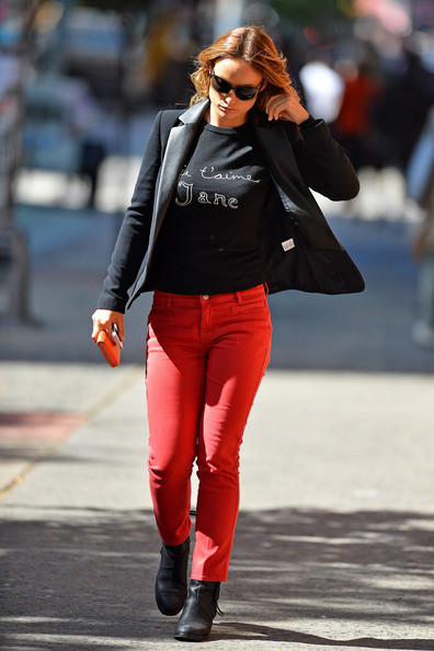 "Olivia Wilde wears red jeans as she ventures out for a stroll in New York City. The ""In Time"" actress, who made an appearance on MSNBC's ""Morning Joe"" this morning, wore a sweater from Je T'aime Jane as she walked around."