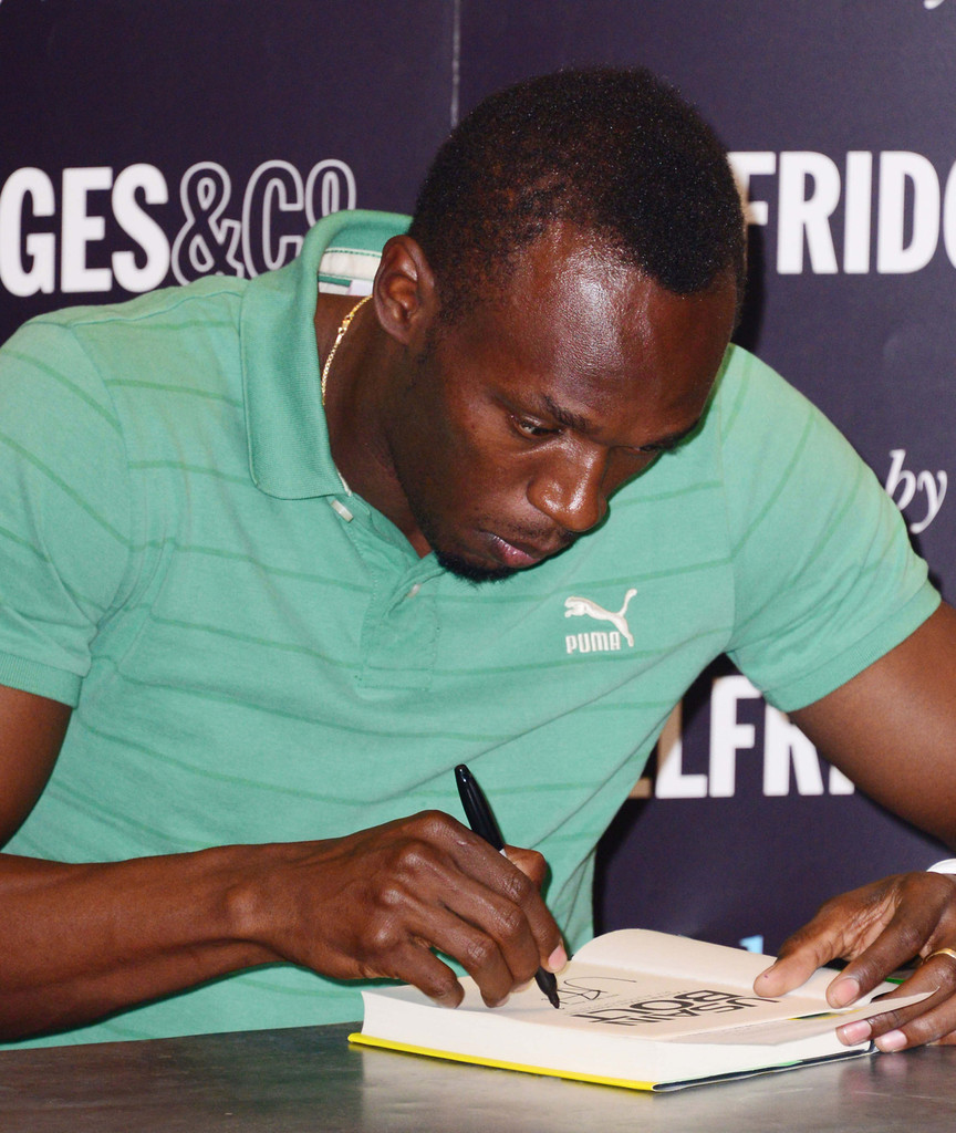 Usain Bolt Signs Copies Of His Autobiography — Part 2  Zimbio. Unique Retail Signs. Rainforest Lettering. Aviation Decals. Farewell Party Banners. Matte Green Decals. Pencil Banners. Shopping Mall Signs. Banners Made To Order