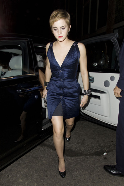 "Emma Watson wears a low cut blue dress as she arrives for a  pre-BAFTAs party at the Box nightclub in the red-light district of Soho. Emma was wearing some seriously ""bling"" cuffs and carrying a sparkly clutch bag as she wandered past the seductive adult sex shops on the way to the party as Emma had a little glance at the naughty sign posts. At one stage, an unidentified man started a confrontation with the actress's security and grabbed him as they walked along. Another man made an attempt to grab Emma, b ut she seemed completely unfazed by the fuss she was causing in the neon streets of Soho. Later on, outside the party Emma's ex-boyfriend George Craig (from the band One Night Only), waited patiently with the forming crowds outside the party. After leaving the party photographers were literally falling over themselves to get a picture of the ""Harry Potter"" star. On the way back in her Rolls Royce, Emma got police escort back to her hotel where another photographer took a tumble trying to get pictures."