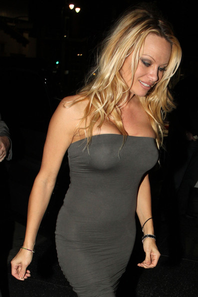 Pam anderson boob pops out
