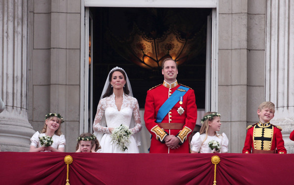 "Prince William Prince William and Catherine ""Kate"" Middleton now know as Duke & Duchess of Cambridge, with L-R Lady Louise Windsor , Grace Van Cutsem , Margarita Linley and Tom Pettifer wave to awaiting crowds from the balcony at Buckingham Palace after their marriage at Westminster Abbey which was watched by 2 billion people across the globe."