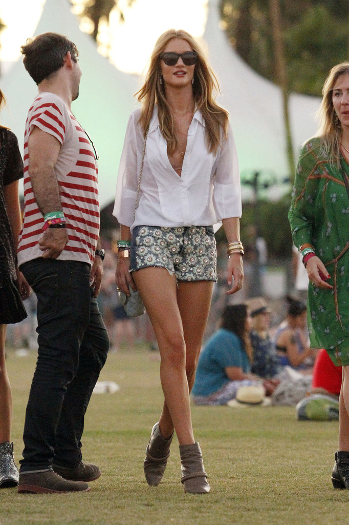 RING ALERT! Gorgeous model/actress Rosie Huntington-Whiteley is seen with a ring on her engagement finger as she enjoys the Arctic Monkeys set while drinking and dancing with friends at the Coachella Music Festival week 2 in Indio.