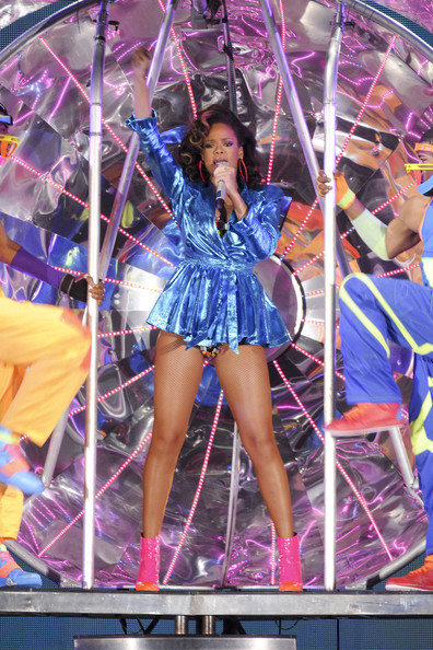 Rihanna Rihanna brightens the stage in a beaded two-piece and pink pvc boots as she performs her sell-out tour at the SECC in Glasgow.