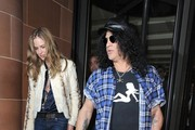 Rock guitarist Slash and television personality Trinny Woodall leave C London restaurant together in Mayfair, London.