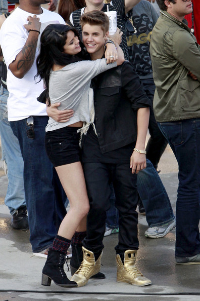 "SELENA VISITS JUSTIN ON SET! Justin Bieber and Selena Gomez embrace and kiss as she visits him on the set of his new music video ""Boyfriend"". The couple looked ecstatic to be seeing each other, with Justin showing Selena around set before listening to music in a Range Rover where she sat on his lap and danced."