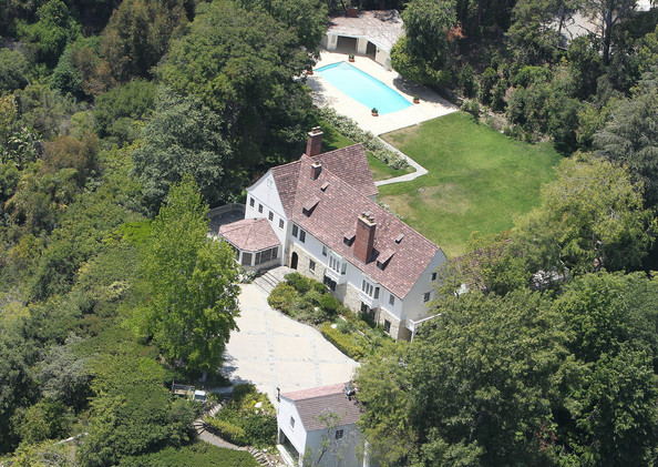 Sandra Bullock has just purchased this massive 8,110 square foot Tudor style mansion located in the exclusive Holmby Hills area of Los Angeles. The Oscar winning actress paid a reported $17 million for the estate which had been listed for sale at $23 million. The 7 bedroom, 8 bathroom home is hidden behind gates and sits on a 4 plus acre lot.  Public and private spaces include a grand scaled living room with fireplace, paneled dining room with fireplace, library, office, eat-in kitchen, work out room and staff quarters. The garden has stunning 270-degree views from downtown to the Pacific Ocean and includes a separate screening room and a pool side pavilion with an adjacent studio or recreational room. Former owners of the hilltop estate, originally constructed in 1940, include actress Marlo Thomas, David Geffen, Norm Pattiz, and Peter Morton.