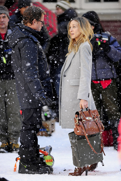 "Sarah Jessica Parker and co-star Greg Kinnear share a kiss in the snow as they film a scene for ""I Don't Know How She Does It"" in NYC. The couple shared a romantic moment before Parker ran over and played around with her on-screen children in the film."
