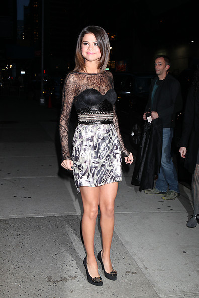 "Selena Gomez Selena Gomez poses for photographs outside of the Ed Sullivan Theater after taping an appearance on ""The Late Show with David Letterman""."
