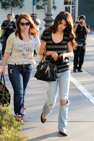 Selena Gomez . Teen sensation Selena Gomez enjoys a bit of retail therapy with a friend at The Grove.