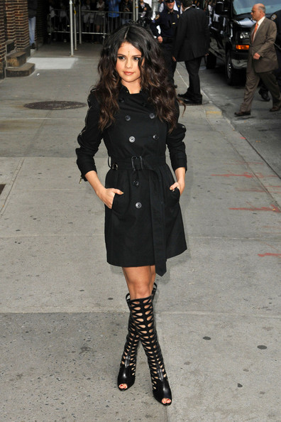 Selena Gomez rocks a cropped black trench coat and knee high gladiator heels before heading into 'The Late Show with David Letterman' in New York City.