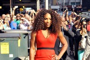 "Tennis legend Serena Williams shows off her incredible physique in a form fitted red zip up dress as she makes her way into ""The Late Show With David Letterman"" in New York City."