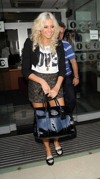 Singer Pixie Lott is all smiles as she leaves the Radio One studios in London. Pixie wore a black, short sleeve blazer, animal print shorts and carried a large patent leather purse.