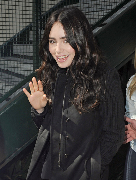 Star of the upcoming Snow White movie 'Mirror Mirror' Lily Collins gives a wave after her interview on 'Extra' at the Grove in Los Angeles.