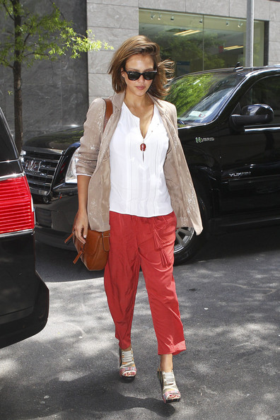 "Superstar Jessica Alba, who is pregnant with her second child, arrives at a Midtown building in NYC. Alba,  who stars in ""Spy Kids 4"" this August, sports a trendy casual look in red trousers and white cotton blouse. The actress attended husband Cash Warren's 10-year reunion at Yale University over the weekend."