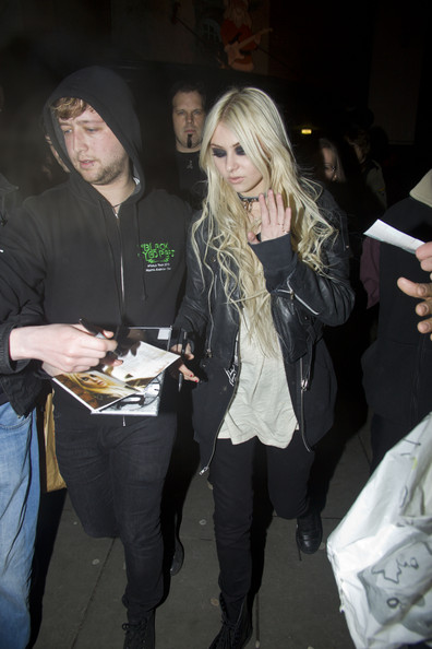 Taylor Momsen .Taylor Momsen leaves Shepherd's Bush Empire after a gig with her band The Pretty Reckless. She signed for fans on the move, then sat up front with the driver and had a laugh with her fellow band member - Ben Phillips as they drove off in the tour bus to Germany for a gig in Cologne at Luxor. Taylor's nail varnish was looking like it needed a new lick of paint.