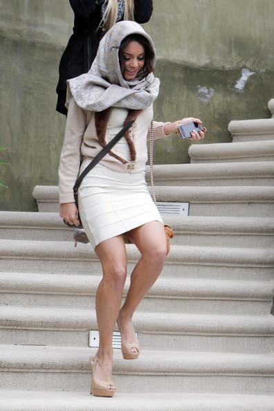 "Vanessa Hudgens A glam looking Vanessa Hudgens seen leaving her house, wearing a Louis Vuitton scarf over head and a furlined jacket. The newly single ""Sucker Punch"" star opted for a curvaceous beige colored dress, with a barrage of rings and bangles to top off her outfit. She was spotted leaving a gym earlier in the day with her younger sister, Stella."
