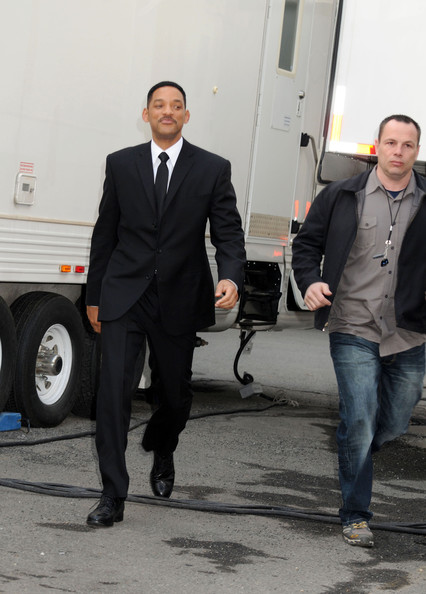 "Will Smith smiles for photos and signs autographs for fans on the set of ""Men in Black III"" in New York."
