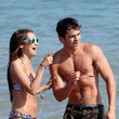 She goofs off at the beach with Zac Efron.