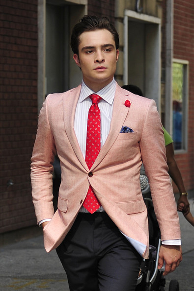 A dapper looking Ed Westwick walks onto the set of