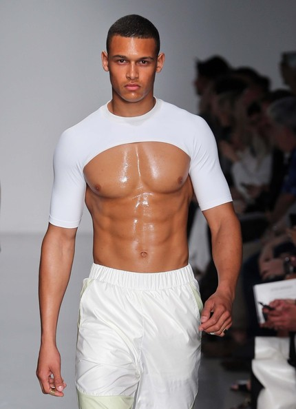 london men s fashion week spring summer 2014 a male model walks on the ...