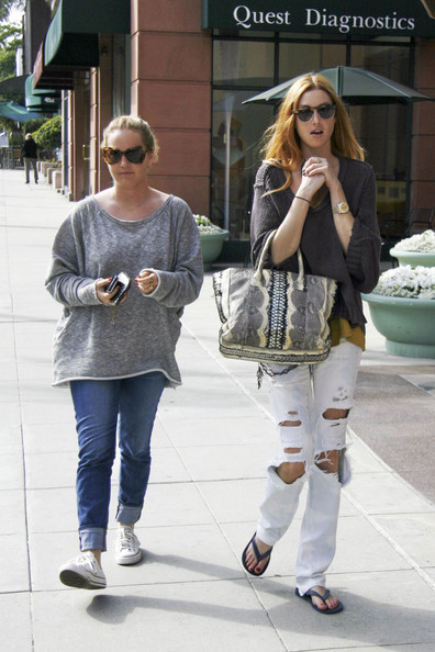 Wednesday June 8 2011.Whitney Port and a friend take a stroll on Bedford Street in Beverly Hills. Whitney was clutching a snakeskin print handbag and looked to have dyed her hair a more reddish tone, a step away from her normal blonde locks.