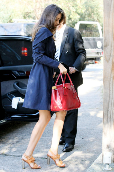 A stylishly-dressed Miranda Kerr arrives at Sun Studios in Sydney, Australia carrying a red Prada handbag. The Victoria's Secret beauty has recently gone back to work as one of Australia's top supermodels after giving birth to her son, Flynn.