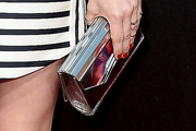 January Jones Metallic Clutch