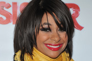 Raven Symone Medium Straight Cut with Bangs