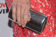 Hilary Swank Metallic Clutch